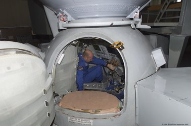 Climbing into the Soyuz simulator at Star City