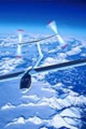 Solar Impulse aircraft over mountains