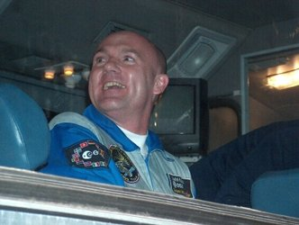 A smiling André Kuipers on the bus after leaving the Kosmonavt Hotel in Baikonour
