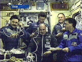André Kuipers with ISS Expedition crews eight and nine shortly after ingress