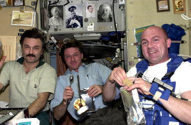 ESA astronaut André Kuipers at breakfast on board ISS with Alexander Kaleri and Michael Foale