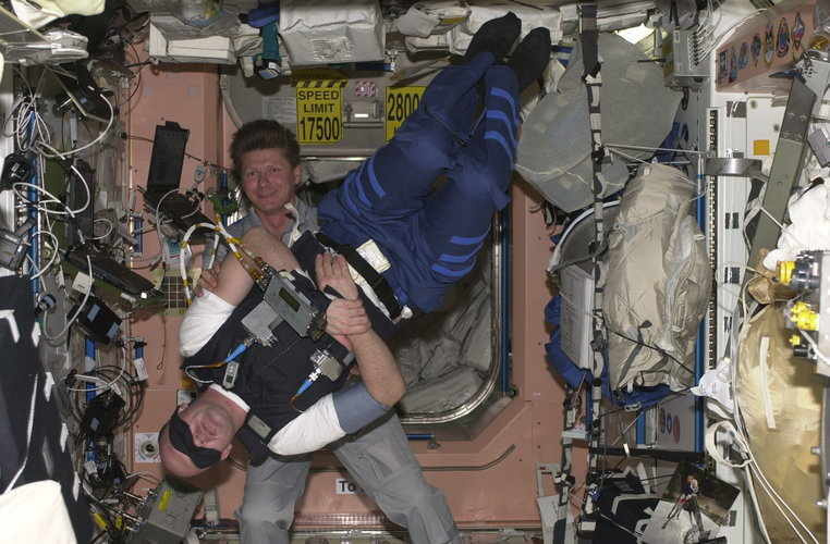 ESA astronaut André Kuipers performs the SUIT experiment, he is assisted by his Russian colleague Gennadi Padalka