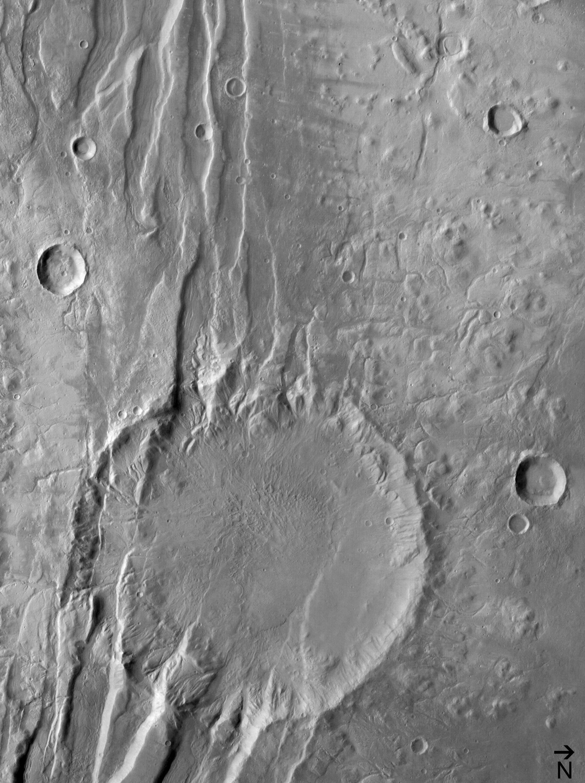 (5) Disrupted crater at Acheron Fossae in black/white
