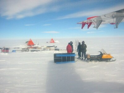 Researchers unloading equipment