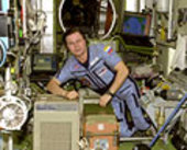 Cosmonaut Nikolai M. Budarin near air cleaner on ISS