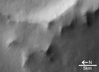 Close-up view of crater and Martian dunes