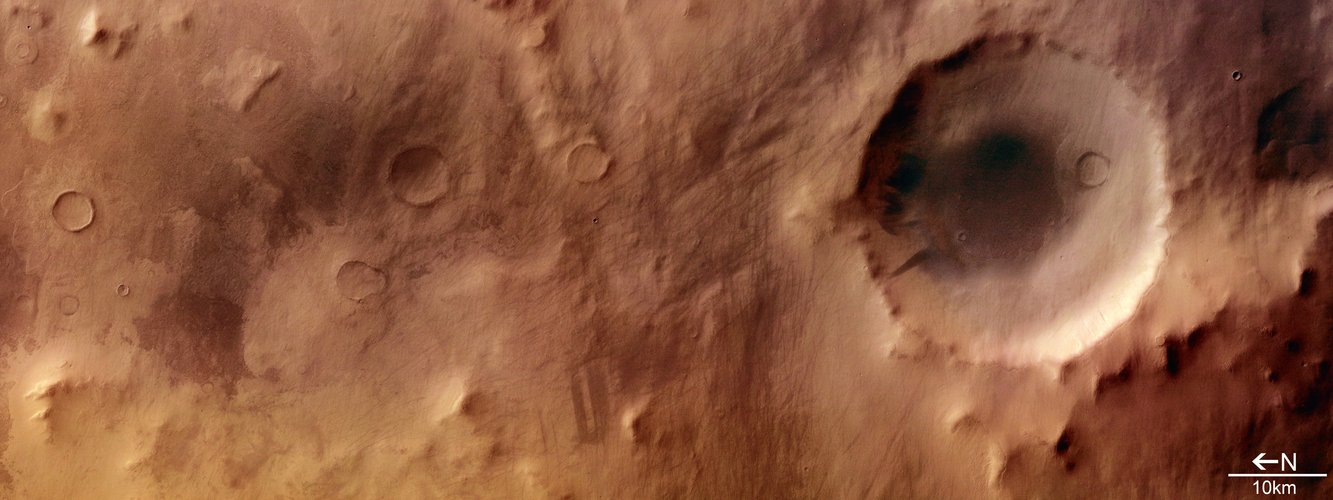 Colour view of impact crater in Promethei Terra