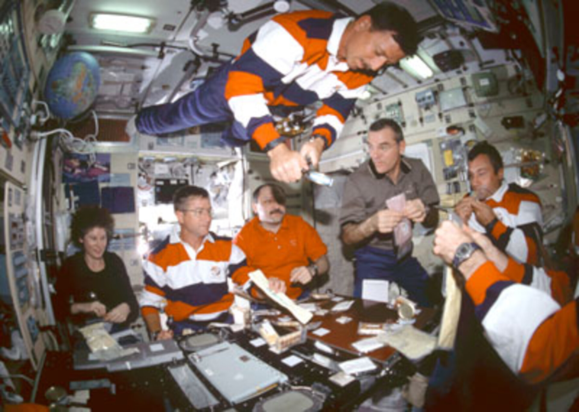 Astronauts share a meal