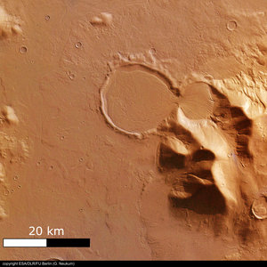 'Hourglass' shaped craters filled with traces of glacier