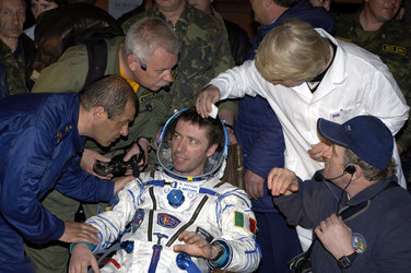 Roberto Vittori is helped out of the Soyuz TMA-5 capsule shortly after landing