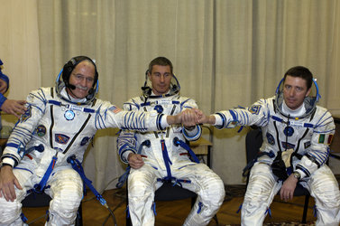 Soyuz TMA-6 crew during the final check of their Sokol pressure suits