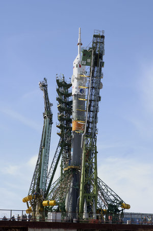 The arms of the launch pad enclose the Soyuz launcher