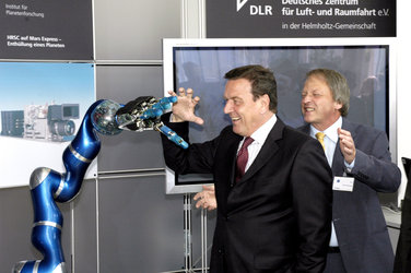Chancellor Gerhard Schröder inspects robotic technology
