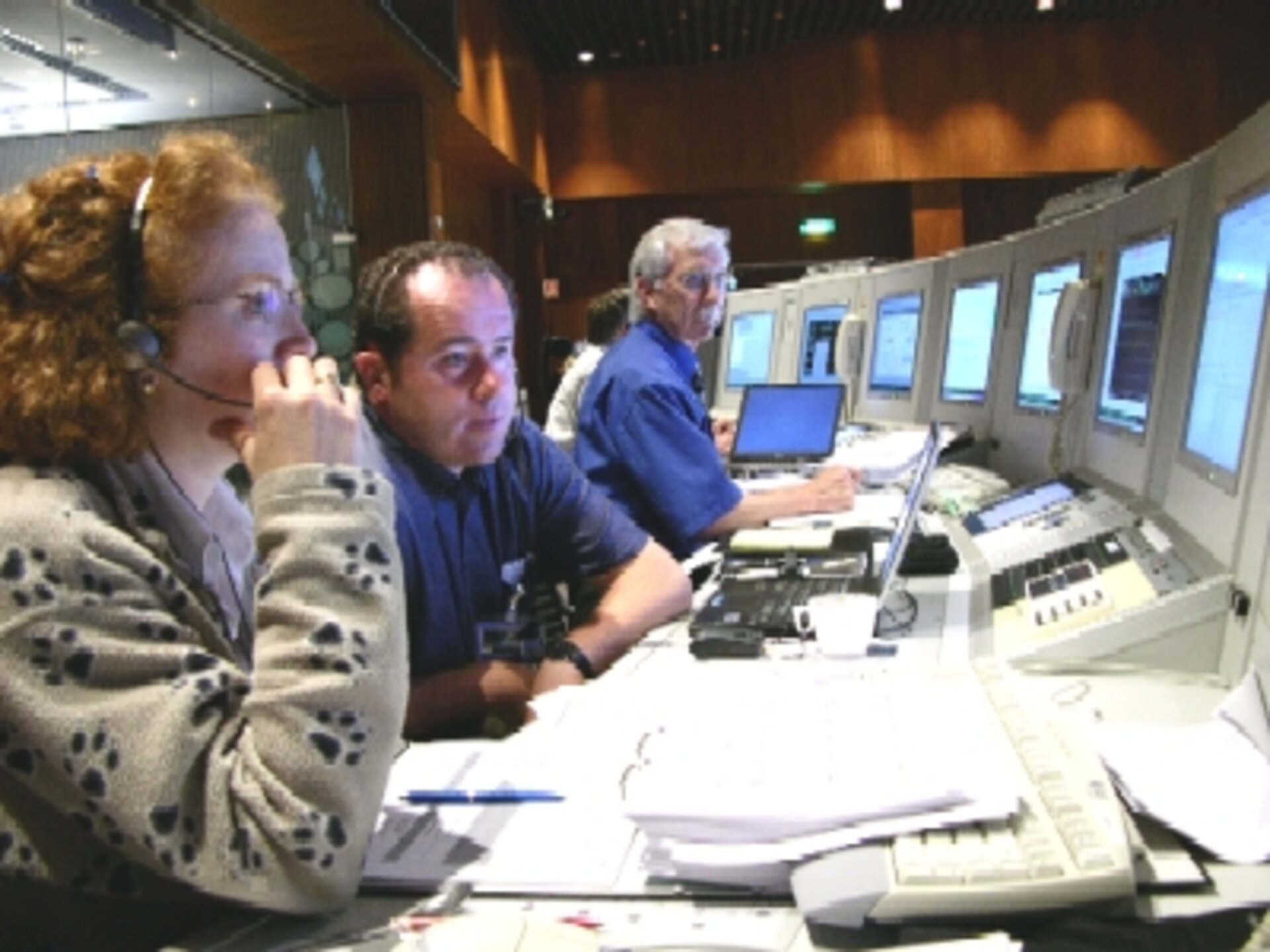 MSG-2 controllers in simulation for LEOP. Flight Director John Dodsworth is in blue shirt at right.