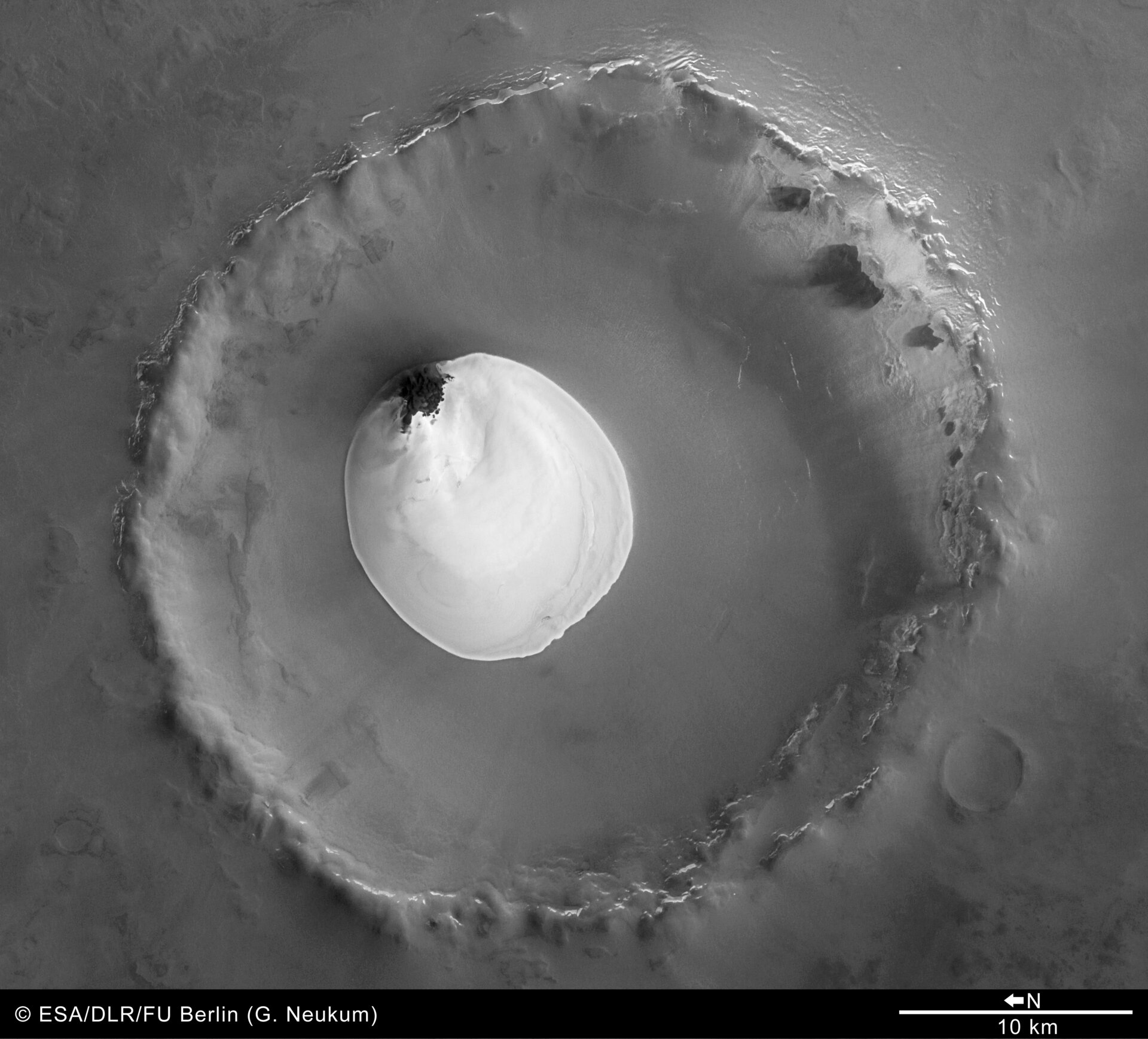 Black and white view of crater with water ice