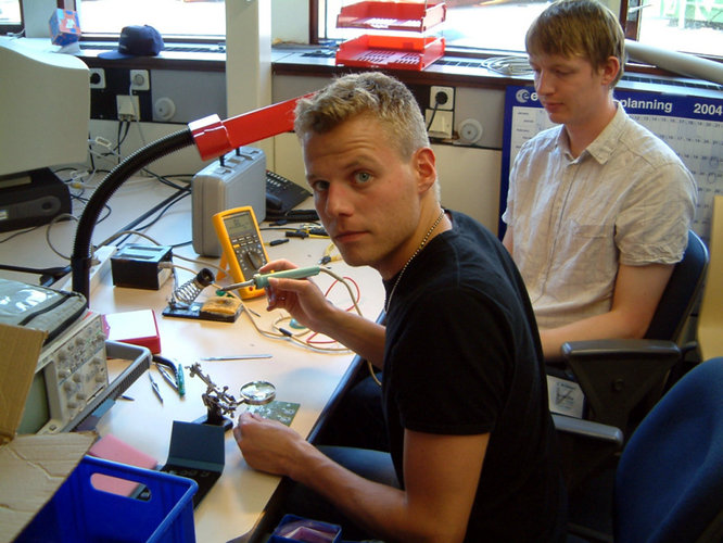 Danish students' first attempt at soldering together components for the on-board computer
