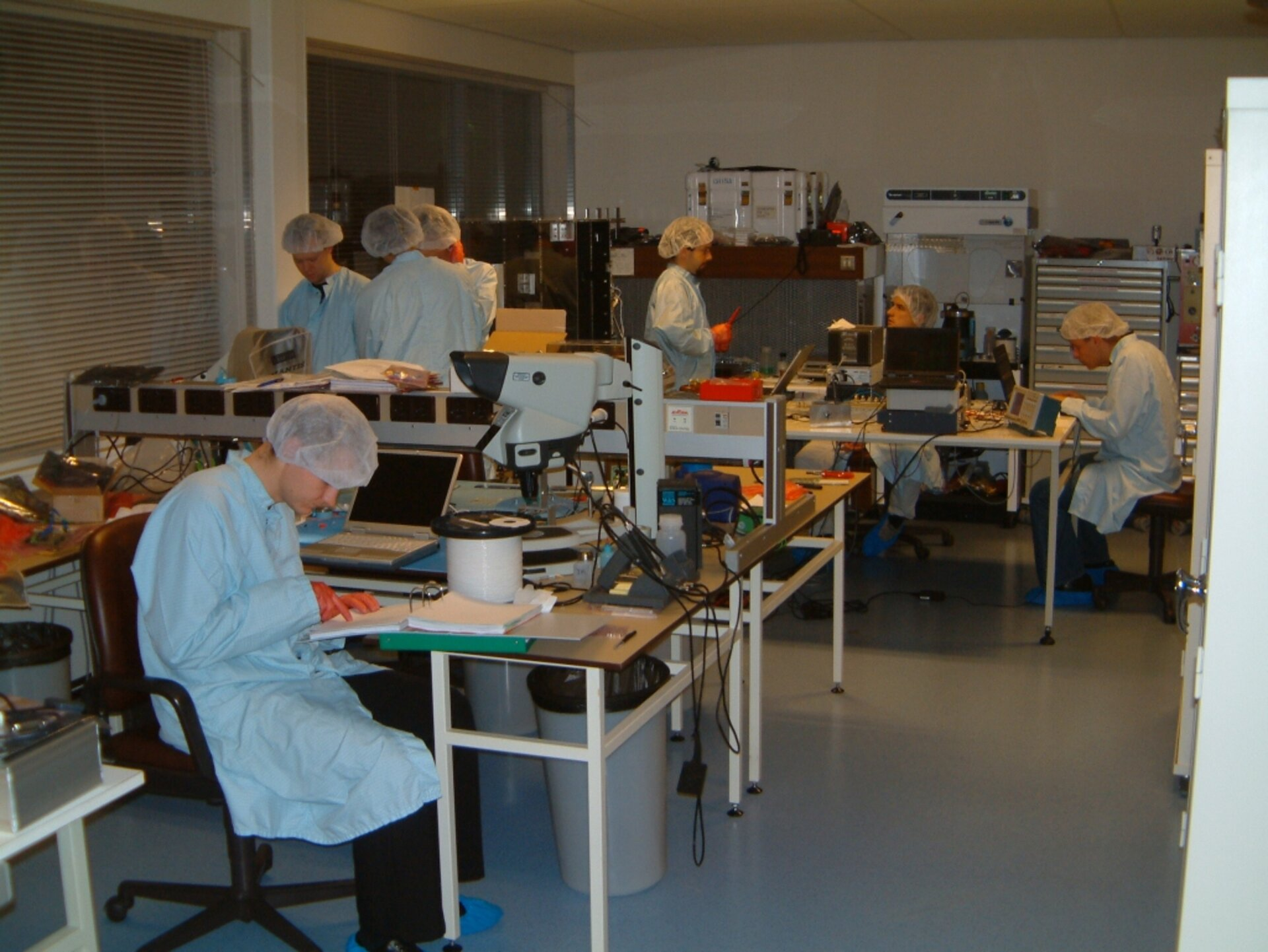 Express team working late in the ESTEC clean room integrating SSETI Express