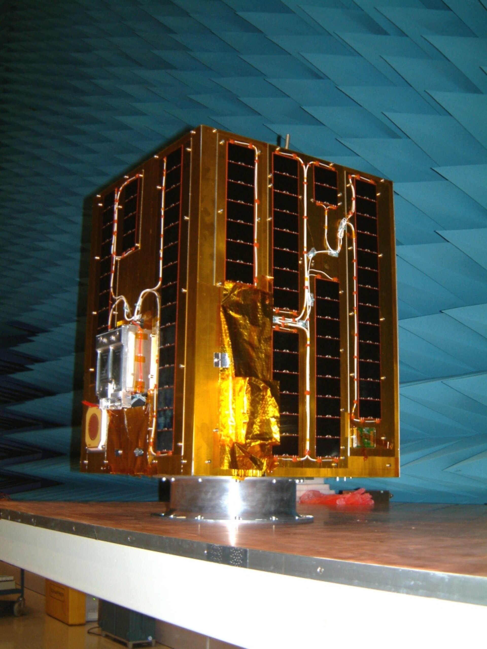 Satellite in the anechoic chamber, ready for electromagnetic compatibility testing