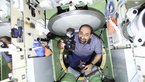 [5/15] Umberto Guidoni entering the Zarya module of the ISS