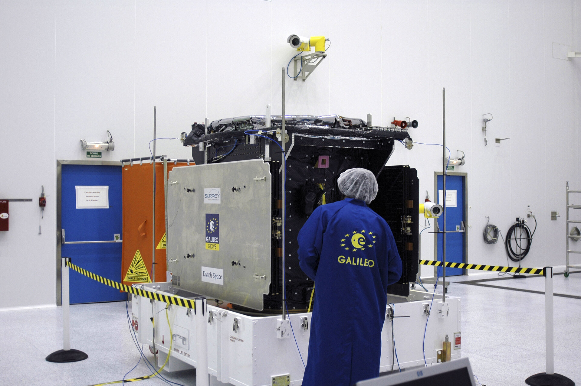 ESA expert inspecting GIOVE-A in clean room