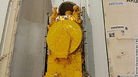 The HOT BIRD 7A satellite and its payload adapter are removed