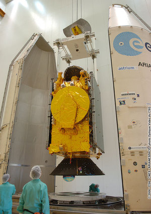 The HOT BIRD 7A satellite and its payload adapter are removed from a transport container