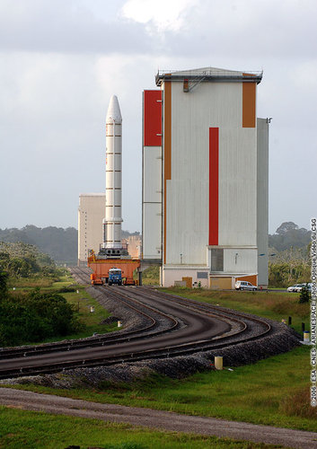 An Ariane 5 Solid Booster Stage, on a  transporter, leaves the Booster Storage Building
