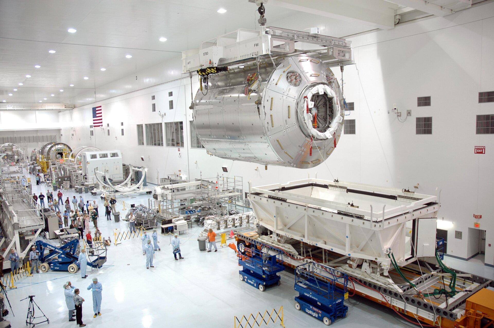 Columbus laboratory is removed from transport container at NASA's Kennedy Space Center