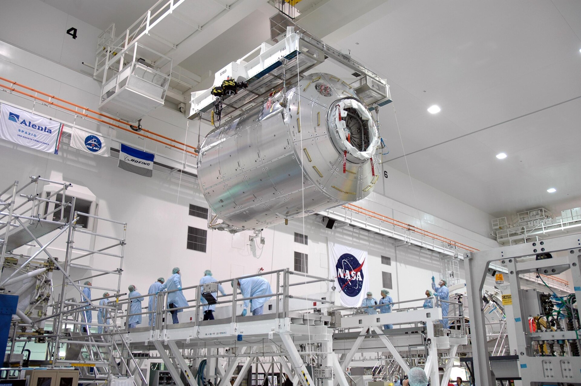 Columbus laboratory is transfered to a work stand inside the Space Station Processing Facility at NASA's Kennedy Space Center