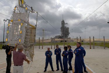 STS-121 crew are instructed in the use of the slidewire basket