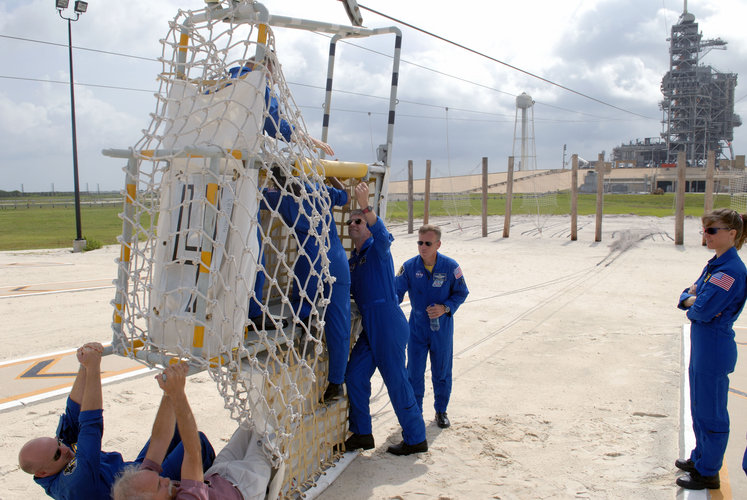 STS-121 crew train to use the slidewire basket at Launch Pad 39B