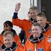 STS-121 walk out in orange pressure suits