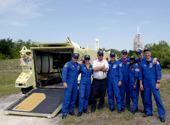 The STS-121 crew with astronaut rescue team leader Capt. George Hoggard after training with the M-113 armoured personel carrier