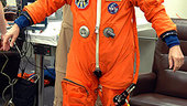 Thomas Reiter checks fitting launch suit