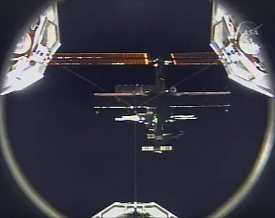A view of ISS from Discovery as the Shuttle approaches for docking