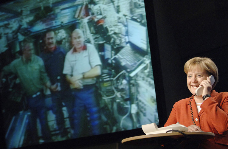 German Chancellor Merkel speaks with ESA astronaut Reiter