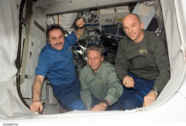 ISS Expedition 13 crew Pavel Vinogradov (left), Thomas Reiter and Jeff Williams wave to the departing STS-121 crew