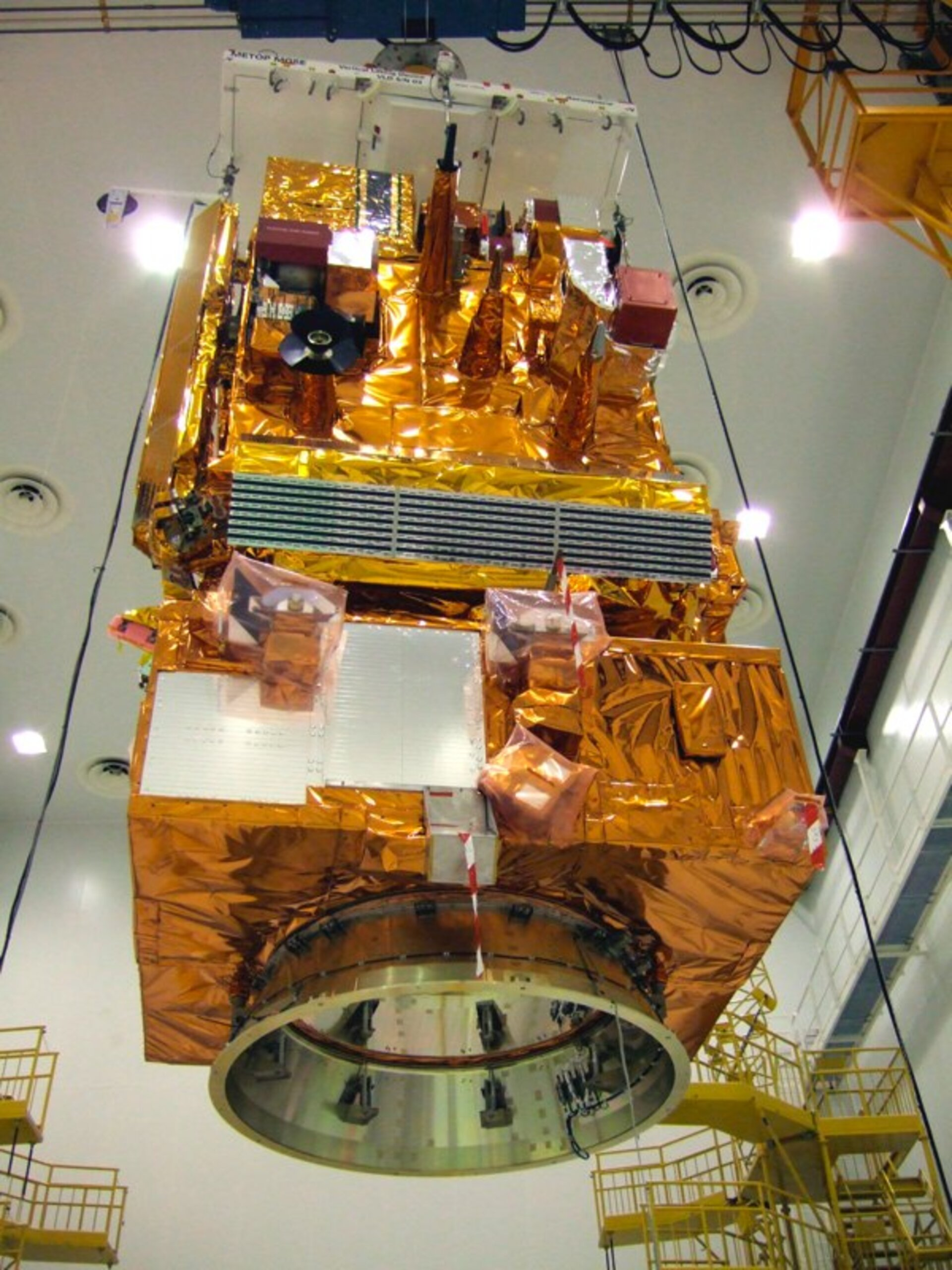 MetOp being lifted by crane