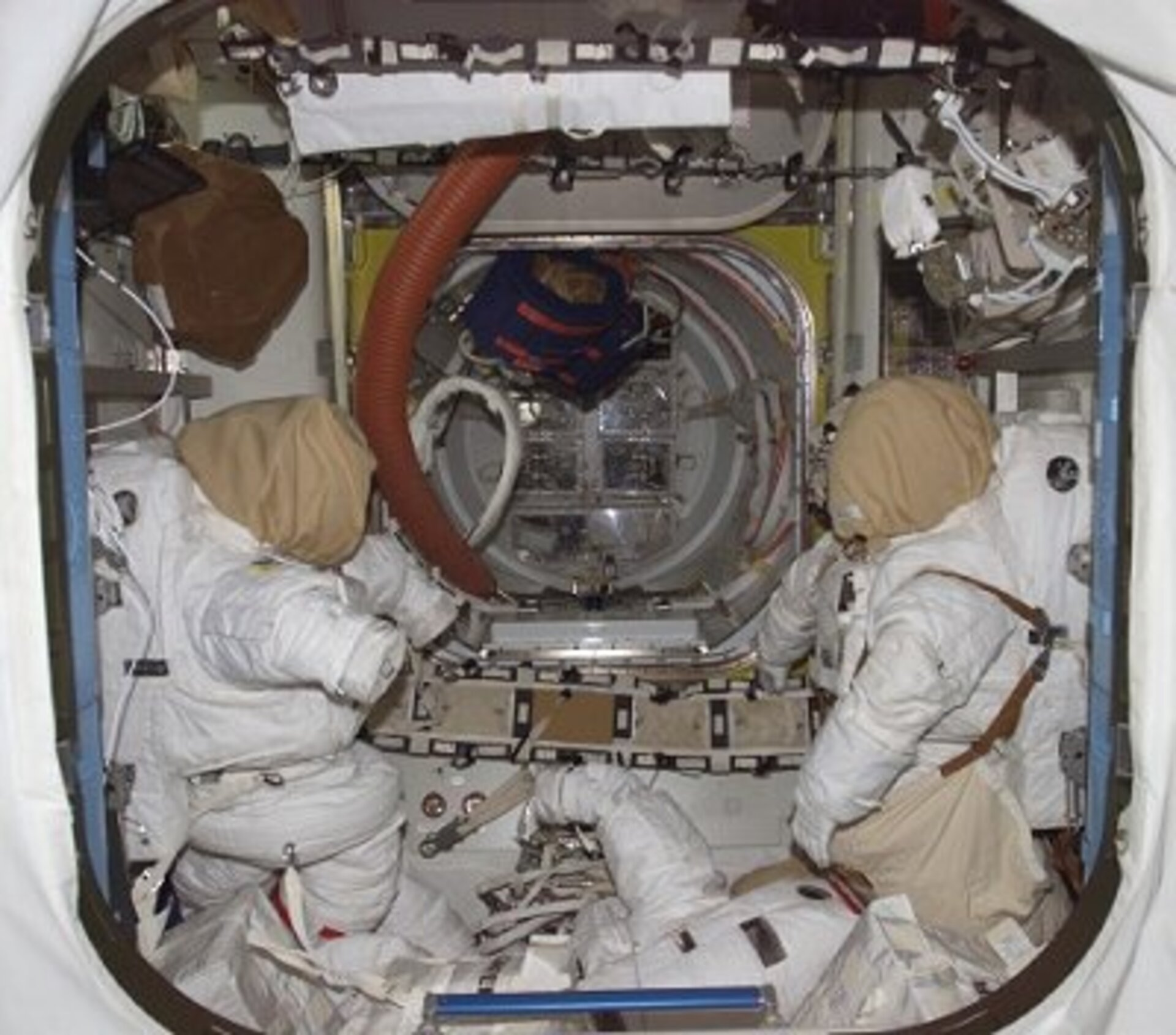 A view of the Quest Joint Airlock - the US EVA spacesuits, like those to be worn by Reiter and Williams on 3 August, are seen to the left and right