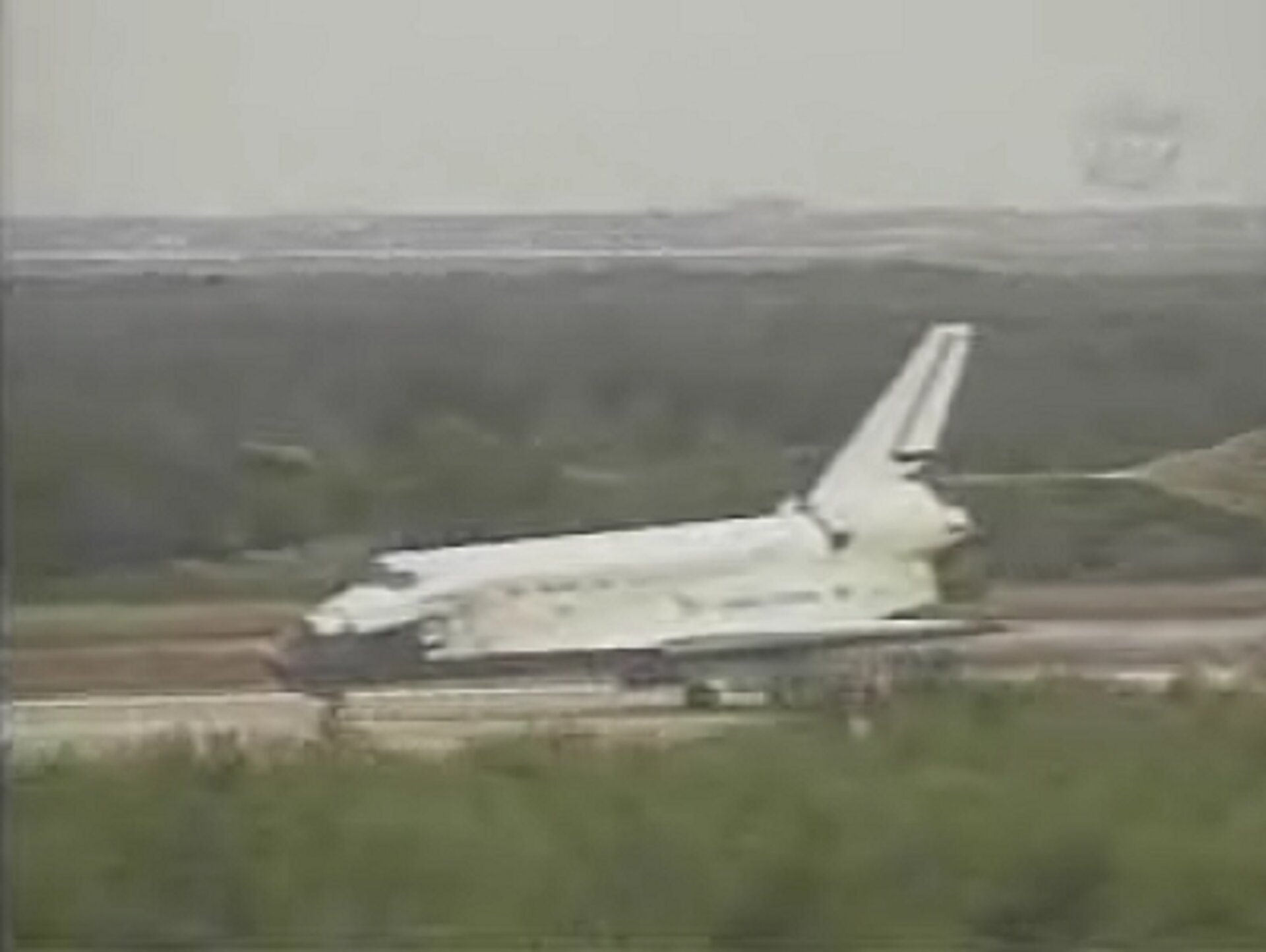 Space Shuttle Discovery lands at KSC concluding the STS-121 mission