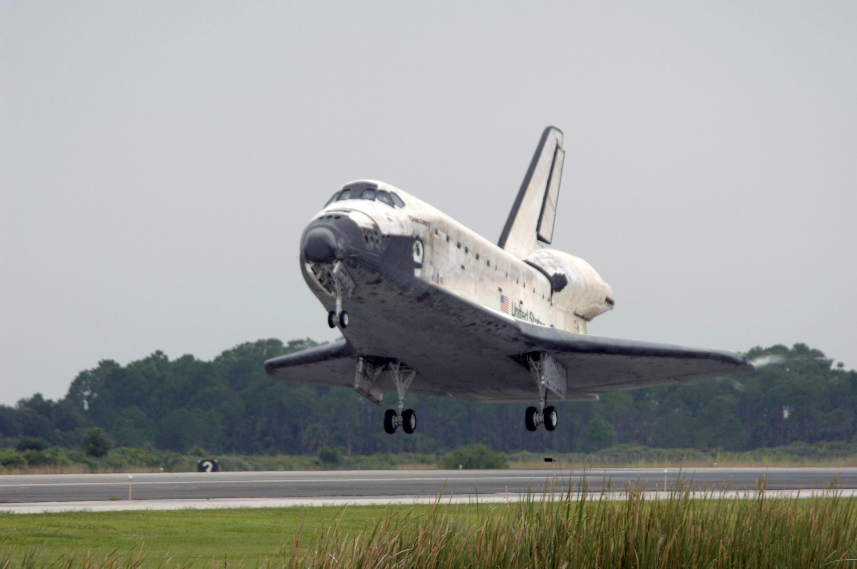 space shuttle landing from space to earth - photo #15