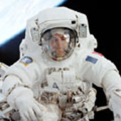 STS-111 Astronaut Perrin Performs Extra Vehicular Activity (EVA)