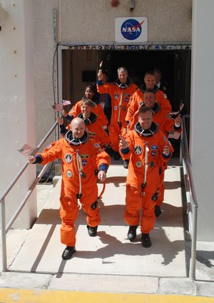 STS-121 crew displays the spirit of the Fourth of July holiday