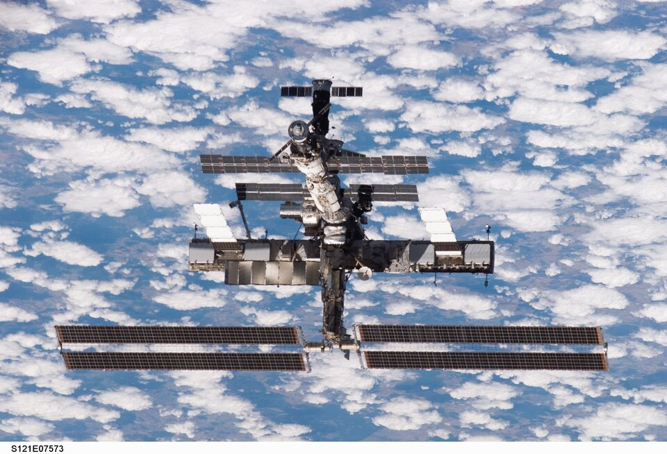 The ISS moves away from Space Shuttle Discovery