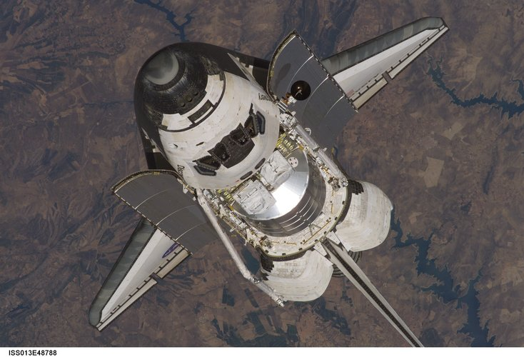 The Space Shuttle Discovery approaches the International Space Station for docking