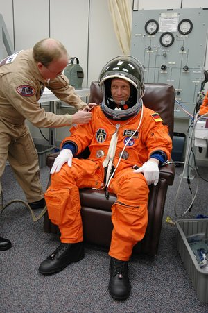 Thomas Reiter is helped with his launch suit before heading to Launch Pad 39B