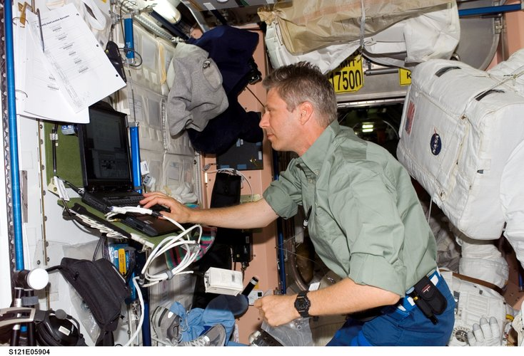 Thomas Reiter uses a computer in the Unity node of the International Space Station