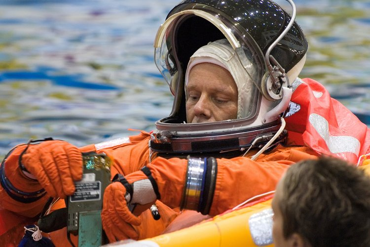 Astronaut Christer Fuglesang floats in a small life raft during an emergency bailout training session