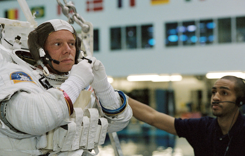 Astronaut Christer Fuglesang prepares for underwater training in Extravehicular Mobility Unit (EMU) spacesuit