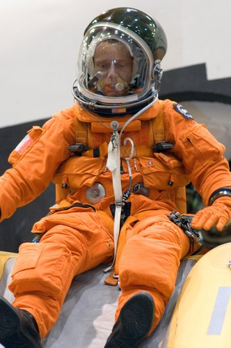 Astronaut Christer Fuglesang using the crew escape slide